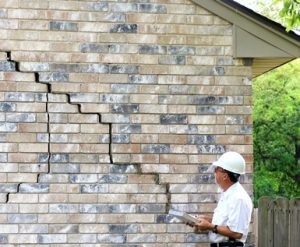 Cracked brick wall on house sold for fast cash